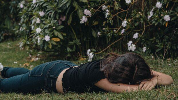 miserable girl among plants